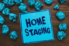 Word writing text Home Staging. Business concept for Act of preparing a private residence for sale in the market Blue paper note r. Eminder crumpled papers royalty free stock photos