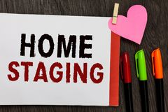 Word writing text Home Staging. Business concept for Act of preparing a private residence for sale in the market Open notebook pag. E markers clothespin holding royalty free stock photos