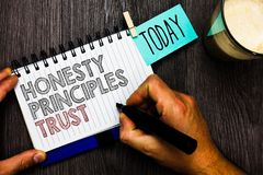 Word writing text Honesty Principles Trust. Business concept for believing someone words for granted Telling truth Man holding mar. Ker notebook clothespin hold Royalty Free Stock Photography