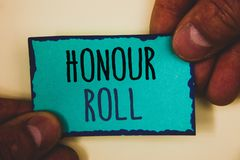 Word writing text Honour Roll. Business concept for List of students who have earned grades above a specific averageMan hold holdi. Words writing texts Honour Royalty Free Stock Photography
