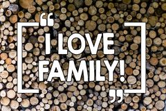 Word writing text I Love Family. Business concept for Good feelings Affection Carefulness for your mother father Wooden. Word writing text I Love Family stock photography