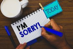 Word writing text I am Sorry. Business concept for To ask for forgiveness to someone you unintensionaly hurt Man holding marker no. Tebook clothespin reminder royalty free stock photos
