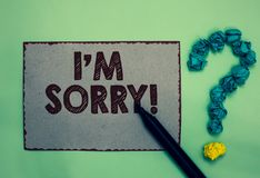 Word writing text I am Sorry. Business concept for To ask for forgiveness to someone you unintensionaly hurt Gray paper marker cru royalty free stock photos
