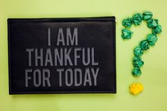 Word writing text I Am Thankful For Today. Business concept for Grateful about living one more day Philosophy Green back black pla. Nk with text green paper lob royalty free stock photo