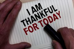 Word writing text I Am Thankful For Today. Business concept for Grateful about living one more day Philosophy Man's hand grasp bl. Ack marker with some black and Stock Photography