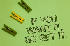 Word writing text If You Want It, Go Get It. Business concept for Make actions to accomplish your goals wishes Outline words green. Middle yellow paper clip on royalty free stock photos
