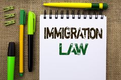 Word writing text Immigration Law. Business concept for National Regulations for immigrants Deportation rules written on Notebook. Word writing text Immigration stock photography