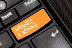 Word writing text Impossible Is Nothing. Business concept for Something which is very difficult to accomplish Keyboard. Key Intention to create computer message stock photos