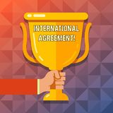 Word writing text International Agreement. Business concept for document signed by countries want make new rules Hand. Word writing text International Agreement stock illustration