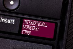 Word writing text International Monetary Fund. Business concept for promotes international financial stability Keyboard. Key Intention to create computer stock images