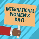 Word writing text International Women S Day. Business concept for International celebration for womens achievement Hu analysis. Hand Holding Blank Colored royalty free illustration