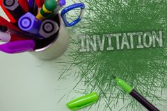 Word writing text Invitation. Business concept for Written or verbal request someone to go somewhere or do something Scratched tab. Le cup with markers ideas royalty free stock photo