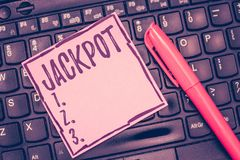 Word writing text Jackpot. Business concept for Large cash prize in game Lottery Big award Gambling related.  stock photo