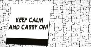 Word writing text Keep Calm And Carry On. Business concept for slogan calling for persistence face of challenge Piece of stock photography