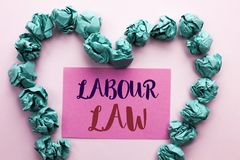 Word writing text Labour Law. Business concept for Employment Rules Worker Rights Obligations Legislation Union written on Pink St. Word writing text Labour Law Stock Photography