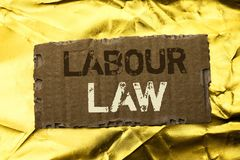 Word writing text Labour Law. Business concept for Employment Rules Worker Rights Obligations Legislation Union written on tear Ca. Word writing text Labour Law Stock Photos