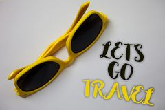Word writing text Let S Go Travel. Business concept for Going away Travelling Asking someone to go outside Trip Sunglass wonderfu. L white background lovely stock photo