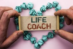 Word writing text Life Coach. Business concept for Mentoring Guiding Career Guidance Encourage Trainer Mentor written on Cardboard. Word writing text Life Coach Royalty Free Stock Photography