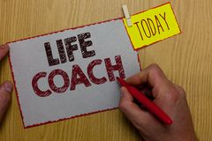 Word writing text Life Coach. Business concept for A person who advices clients how to solve their problems or goals Man holding m. Arker paper clothespin stock photos