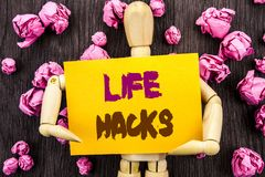 Word, writing, text  Life Hacks. Conceptual photo Solution Hacking Hack Trick To Help Efficiency written on Sticky Note Holding By. Word, writing, text  Life Royalty Free Stock Images