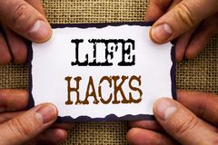 Word, writing, text  Life Hacks. Conceptual photo Solution Hacking Hack Trick To Help Efficiency written on Sticky Note Paper Hold. Word, writing, text  Life Royalty Free Stock Photos