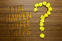 Word writing text Life Happen Coffee Helps. Business concept for Have a hot drink when having problems troubles Wooden floor with. Some letters yellow paper stock photo