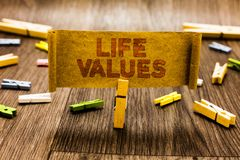 Word writing text Life Values. Business concept for things that you believe are important in the way you live Clothespin holding o royalty free stock images