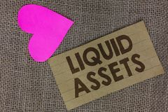 Word writing text Liquid Assets. Business concept for Cash and Bank Balances Market Liquidity Deferred Stock Piece squared paperbo. Ard paper heart jute royalty free stock images