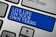 Word writing text Live Life On Your Own Terms. Business concept for Give yourself guidelines for a good living Grey silvery keyboa. Rd with bold blue color stock photos
