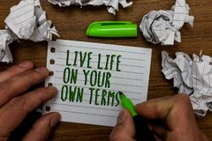 Word writing text Live Life On Your Own Terms. Business concept for Give yourself guidelines for a good living Hand hold green pen. And words on white page stock images