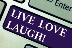 Word writing text Live Love Laugh. Business concept for Be inspired positive enjoy your days laughing good humor Keyboard key. Intention to create computer stock photo