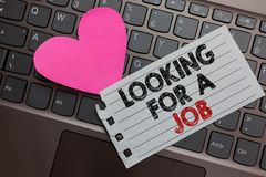 Word writing text Looking For A Job. Business concept for Unemployed seeking work Recruitment Human Resources Ashy computer keyboa. Rd with yellow button black royalty free stock photos