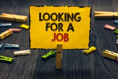 Word writing text Looking For A Job. Business concept for Unemployed seeking work Recruitment Human Resources Blacky wooden desk l. Aid paper clip randomly one royalty free stock photos