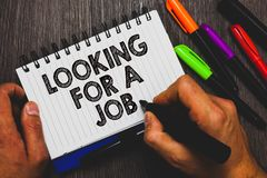 Word writing text Looking For A Job. Business concept for Unemployed seeking work Recruitment Human Resources Hand holding pen and. Paper sketch words near lie stock photo