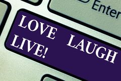 Word writing text Love Laugh Live. Business concept for Be inspired positive enjoy your days laughing good humor. Keyboard key Intention to create computer royalty free stock image