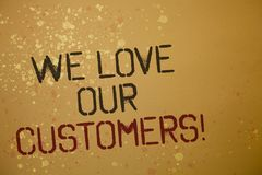 Word writing text We Love Our Customers Call. Business concept for Client deserves good service satisfaction respect Ideas message. S brown background splatters Stock Image