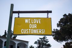 Word writing text We Love Our Customers Call. Business concept for Client deserves good service satisfaction respect Wooden board. Hang hanging post ideas Stock Photos