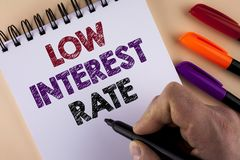 Word writing text Low Interest Rate. Business concept for Manage money wisely pay lesser rates save higher written by Man with Mar. Ker Notepad the plain royalty free stock image