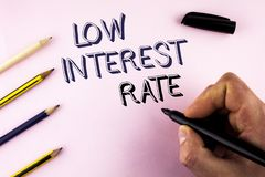 Word writing text Low Interest Rate. Business concept for Manage money wisely pay lesser rates save higher written by Man on plain. Word writing text Low royalty free stock photo