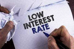 Word writing text Low Interest Rate. Business concept for Manage money wisely pay lesser rates save higher written by Man on Tear. Word writing text Low Interest stock image