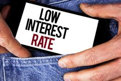 Word writing text Low Interest Rate. Business concept for Manage money wisely pay lesser rates save higher written on Mobile phone. Word writing text Low stock image