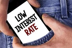 Word writing text Low Interest Rate. Business concept for Manage money wisely pay lesser rates save higher written on Mobile phone. Word writing text Low stock photography