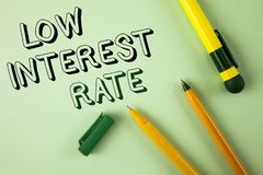 Word writing text Low Interest Rate. Business concept for Manage money wisely pay lesser rates save higher written on Plain Green. Word writing text Low Interest royalty free stock photo