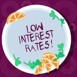 Word writing text Low Interest Rates. Business concept for meant to stimulate economic growth making it cheaper Cutouts. Of Sliced Lime Wedge and Herb Leaves on royalty free illustration