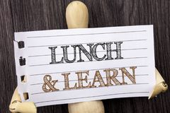 Word, writing, text  Lunch And Learn. Conceptual photo Presentation Training Board Course written on torn paper holding by sculptu. Word, writing, text  Lunch Royalty Free Stock Photos
