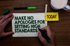 Word writing text Make No Apologies For Setting High Standards. Business concept for Seeking quality productivity Man holding mark. Er notebook clothespin stock photo