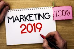 Word writing text Marketing 2019. Business concept for New Year Market Strategies Fresh start Advertising Ideas written by Man on stock photography