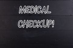 Word writing text Medical Checkup. Business concept for thorough physical examination includes variety of tests Wooden stock photo