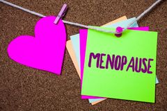 Word writing text Menopause. Business concept for Cessation of menstruation Older women hormonal changes period Heart thread stick. Y small cliped string thumb royalty free stock photos