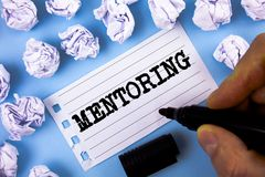 Word writing text Mentoring. Business concept for To give advice or support to a younger less experienced person written by Man on. Word writing text Mentoring Royalty Free Stock Photo